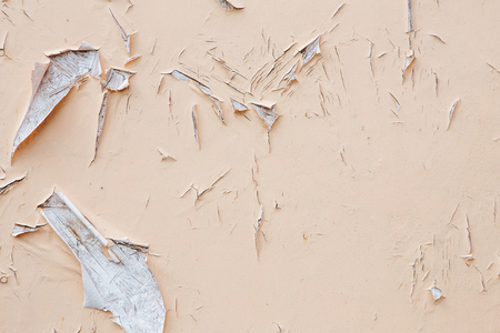 of irradiated: Cracking and peeling paint on a wall. Vintage wood background with peeling paint. Old board with Irradiated paint Stock Photo