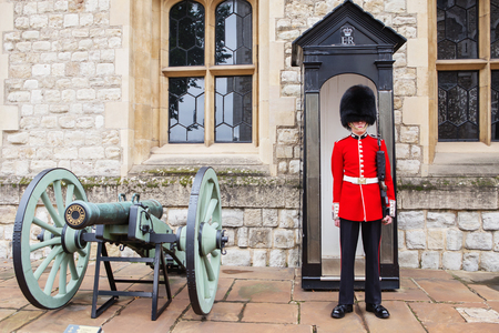 LONDON, UNITED KINGDOM - AUGUST 21, 2017 : Royal Guard at Tower of London, England. British Guards in red uniform are the sign of London. The Grenadier Guards (GREN GDS)