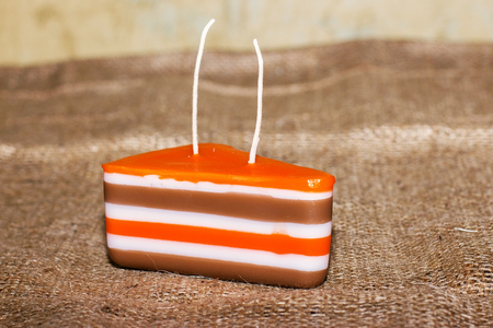 doublet: Decorative Handmade candles in the shape of a cake Editorial