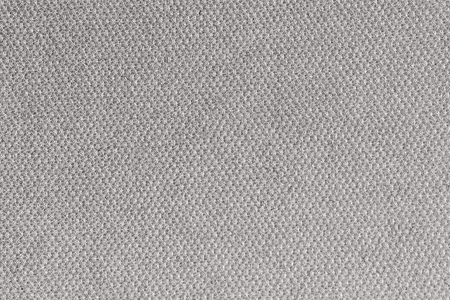 Close up on knit woolen fur texture. fluffy woven thread sweater as a background.