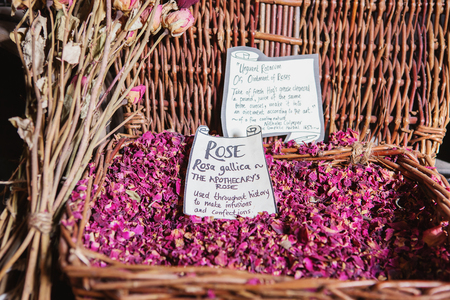 LONDON - AUGUST 23, 2017: Dried rose petals. rosa gallica, apothecary rose in The Old Operating Theatre Museum and Herb Garret, London, UK Editorial