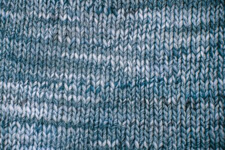 Blue Wool scarf texture close up. Knitted jersey background with a relief pattern. Braids in machine knitting pattern Stock Photo