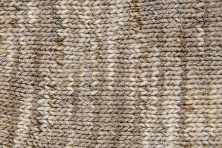 Wool scarf texture close up. Knitted jersey background with a relief pattern. Braids in machine knitting pattern Stock Photo