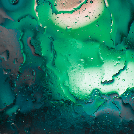 Abstract background of oil mixed with water in different color variations