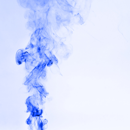 Beautiful blue Smoke on White background Stock Photo