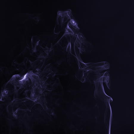 Beautiful ultra violet smoke against dark background Stock Photo