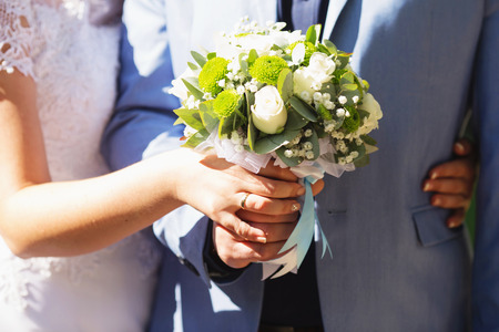 A beautiful wedding bouquet with white roses and green chrysanthemums