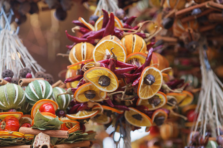 Close up of Christmas market stall in Vienna, Austria. Christmas decorations made from dried fruits, vegetables and spices