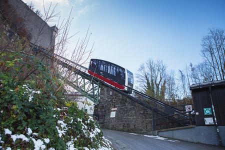 Salzburg, Austria  - November 28, 2018: A funicular railway car in its way to Hohensalzburg Fortress.The Festungsbahn is a funicular railway providing access to Hohensalzburg Fortress.