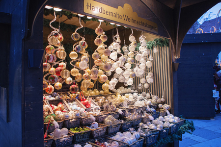 Vienna, Austria - November 25, 2018: Close up of Christmas market stall. Christmas decorations at a Christmas market. Merry christmas, cute festive decoration, beautiful toys for new year Editorial