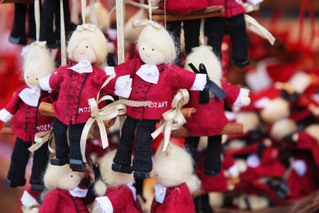 Vienna, Austria - November 25, 2018: Close up of Christmas market stall. Mozart figures at a Christmas market. Merry christmas, cute festive decoration, beautiful toys for new year Editorial
