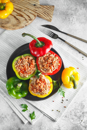 Colorful stuffed peppers with rice and minced meat. Stuffed paprika with rice and chopped meat. Flat lay composition