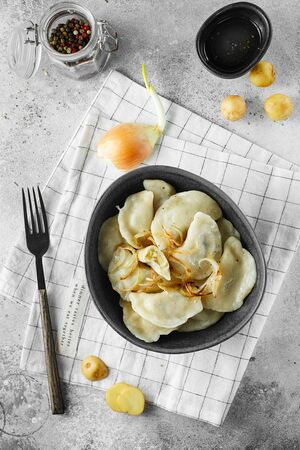Dumplings, filled with mashed potatoes and onions. Russian, Ukrainian or Polish dish: varenyky, vareniki, pierogi, pyrohy. Food photography. flat lay composition Imagens