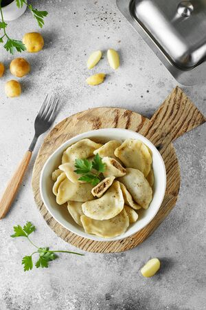 Dumplings, filled with mashed potatoes and liver. Russian, Ukrainian or Polish dish: varenyky, vareniki, pierogi, pyrohy. Food photography. Flat lay composition Stock fotó
