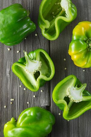 Sweet green pepper on wooden background. Fresh yellow green bell pepper (capsicum)