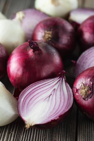 red onions on rustic wood or on dark background. Red onion halves. Food Ingredients