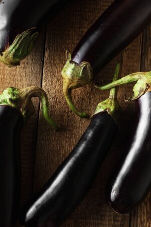 Eggplant from the garden.Eggplant on wooden background. Healthy food. Fresh eggplant, dark photography