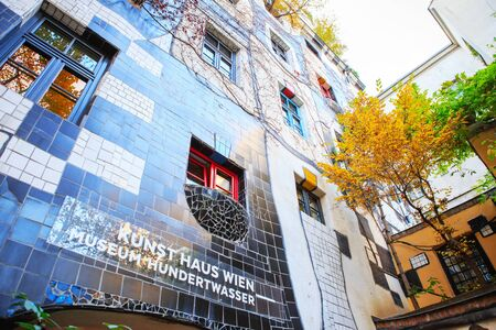 The Museum Hundertwasser in Kunst Haus Wien in Vienna, Austria. Ecological commitment concept– grass roofs and planted trees in bright, glaring colours building facades
