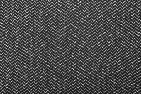 Gray wool pattern, textured salt and pepper style black and white melange upholstery. Fabric background copy space. Black and white herringbone fabric.