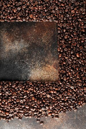 Black coffee beans studio shot. Freshly roasted coffee beans as texture background. Frame of coffee beans with copy space for text Imagens