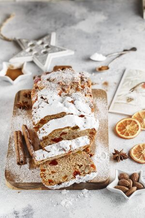 Stollen is fruit bread of nuts, spices, dried or candied fruit, coated with powdered sugar. It is traditional German bread eaten during the Christmas season. New year prep. Holiday baking