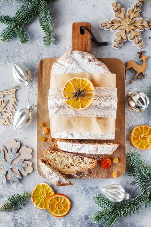 Holiday baking. Christmas cake. Stollen is fruit bread of nuts, spices, dried or candied fruit, coated with powdered sugar. It is traditional German bread eaten in the Christmas season. New year prep