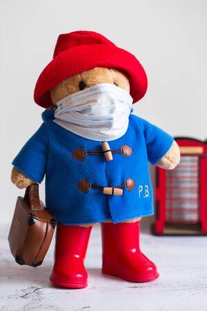 Coronavirus Outbreak. Quarantine in London. Paddington soft toy in a medical mask. Coronavirus Control