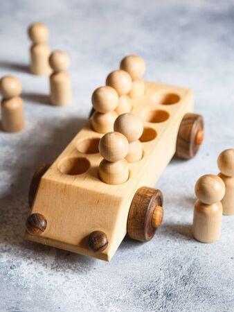 Children's wooden toys. Children wooden car with passengers. Natural wood construction set. Educational equipment.