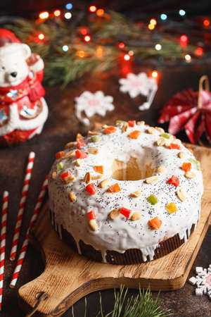 Christmas cake with fruits and nuts. Fruit cake. Christmas baking. Preparations for the holiday. Christmas dessert table. Gift idea 写真素材