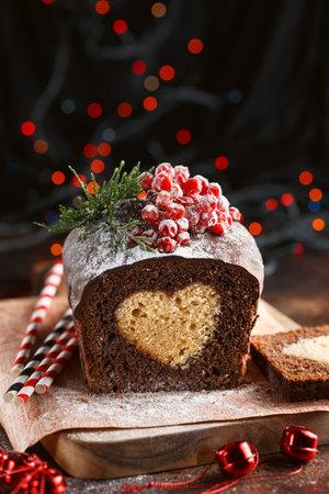 Christmas cake. Chocolate cake cutaway. Christmas baking. Preparations for the holiday. Christmas dessert table. Gift idea