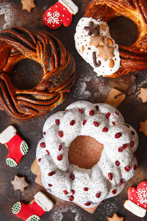 Christmas cake with fruits and nuts. Fruit cake and Cinnamon Twist Bread Wreath. Christmas Wreath Bread. Christmas baking.