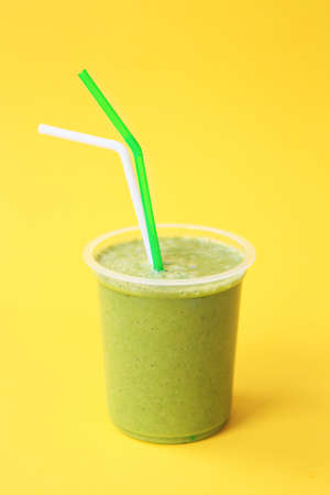Healthy fresh green smoothie or fresh juice. Summer cold drink. Organic Protein cocktails with fruits and vegetables. Vegan drink, plant-based smoohty. Green living concept.