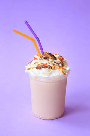 Healthy fresh chocolate smoothie or milkshake. Summer cold drink. Protein cocktails with chocolate cookies and caramel topping