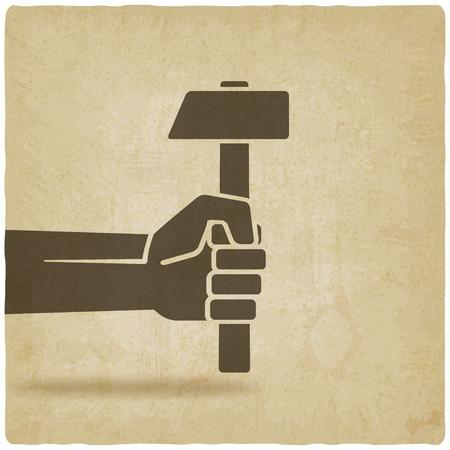 martillo: trabajando s�mbolo de la mano con el martillo viejo fondo - ilustraci�n vectorial. eps 10