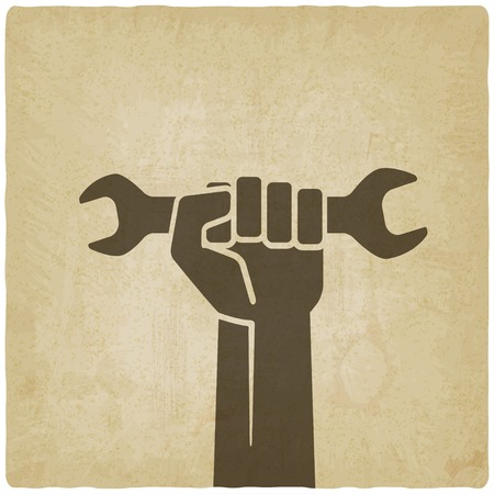 hand holding paper: worker hand with wrench symbol