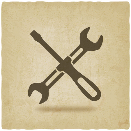 screw driver and wrench symbol old background