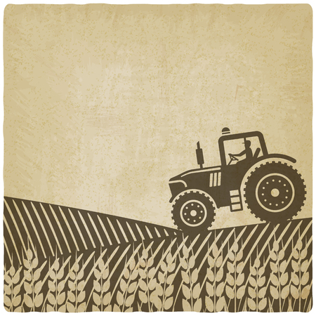tractor in het veld oude achtergrond.