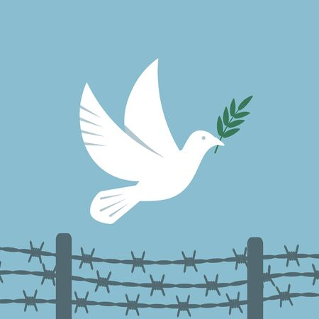 Symbol peace white dove flies over the barbed wire