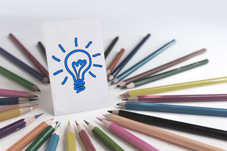 path to success: colored pencils around idea card with clipping path, easily to change color of light bulb.
