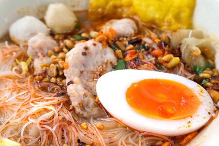 close up food: Close up spicy noodle with  boiled egg chinese food style