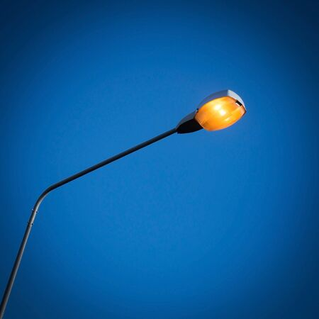 electric avenue: Minimal style of street light with clear blue sky background