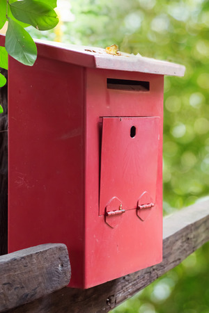 green nature: Red mailbox with green nature background