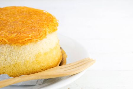 yolks: Gold egg yolks thread cake  on white wood background Stock Photo