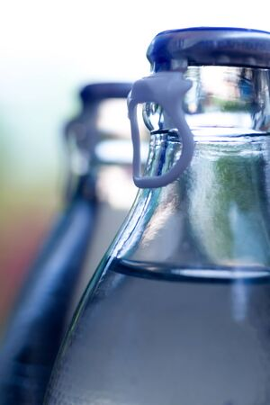 purify: Water glass bottles with selective focus point Stock Photo