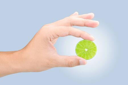 squeezing: Male hand squeezing lime with clipping path