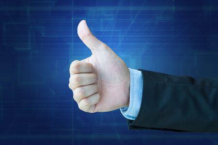 dedo: pulgar del hombre de negocios con el camino de recortes Foto de archivo