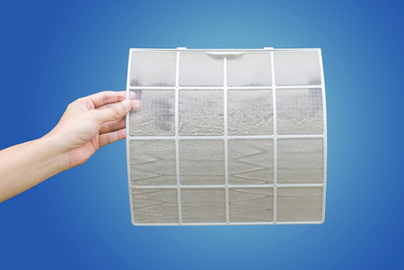 very dirty: Man holding very dirty air conditioner filter with clipping path