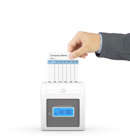 out time: Hand putting paper card in time recorder machine with clipping path