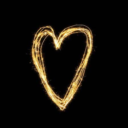 Heart shape from sparkler on black background