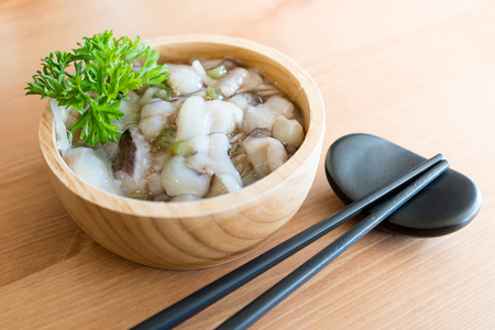 Raw squid mixed with wasabi , Japanese food (Tako wasabi)  Stock Photo